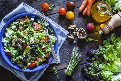 Fresh salad plate on rustic wooden table