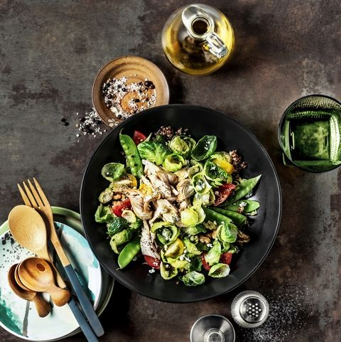 fresh salad with chicken breast on rusty background