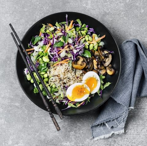 Fresh salad with fried rice and boiled eggs