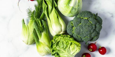 fresh vegetables broccoli, cabbage, radish, fennel, bok choy and lettuce on white background