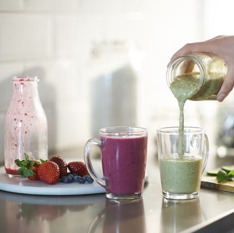 freshly made smoothies poured into glasses