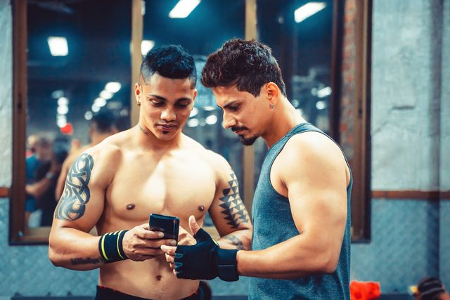 friends after workout a fitness centre posting an image on the social media