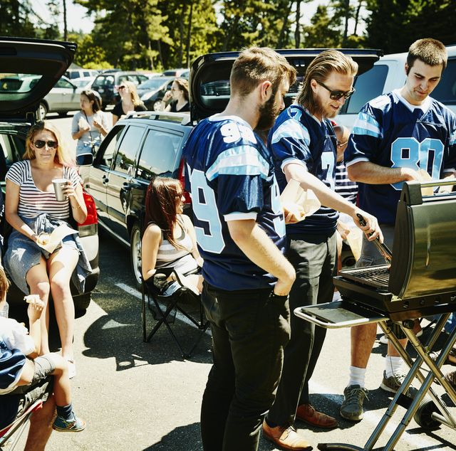 friends barbecuing during tailgating party