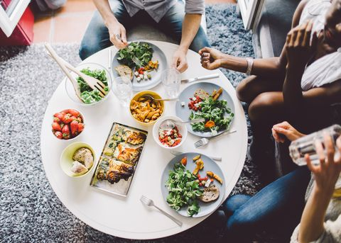 three women enjoying appetizers and wine
