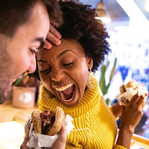 winter date ideas - Friends playing while eating a burger