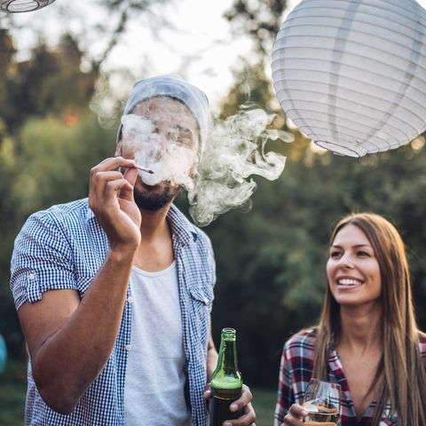 Friends smoking and drinking at a party