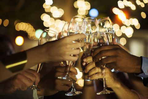 Friends toasting each other at party