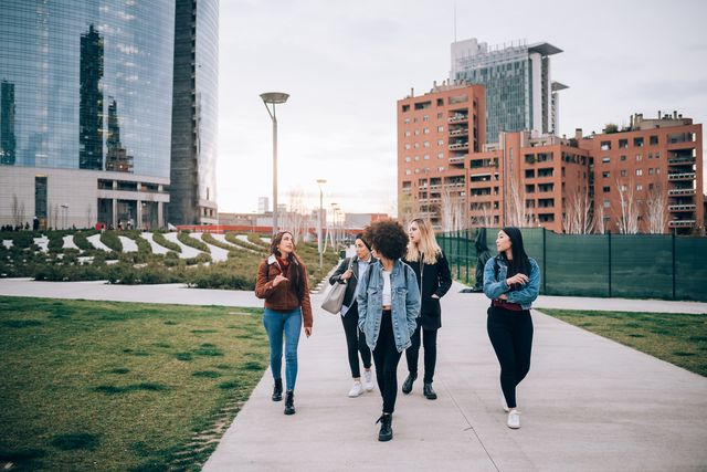 friends walking in street, milan, italy