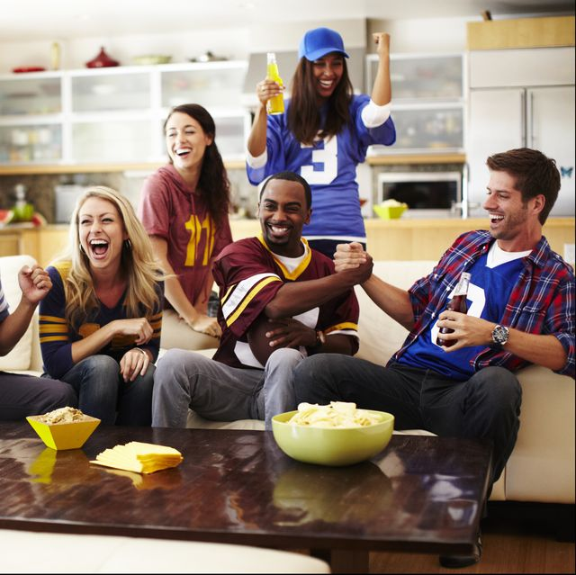 friends watching football in living room