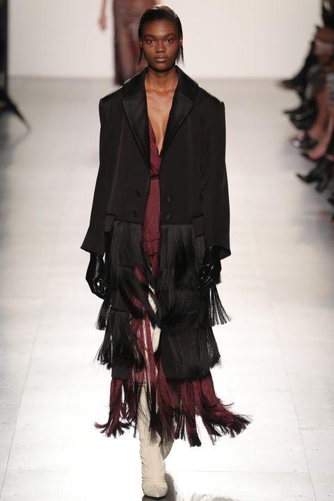 Fashion show, Shoulder, Textile, Joint, Outerwear, Runway, Style, Fashion model, Fashion, Neck,