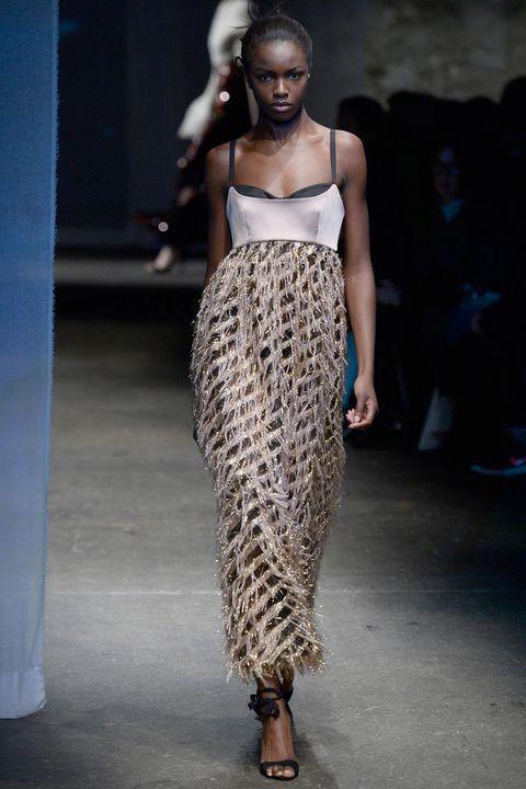 Human, Fashion show, Human body, Fashion model, Runway, Style, Waist, Street fashion, Fashion, Neck,