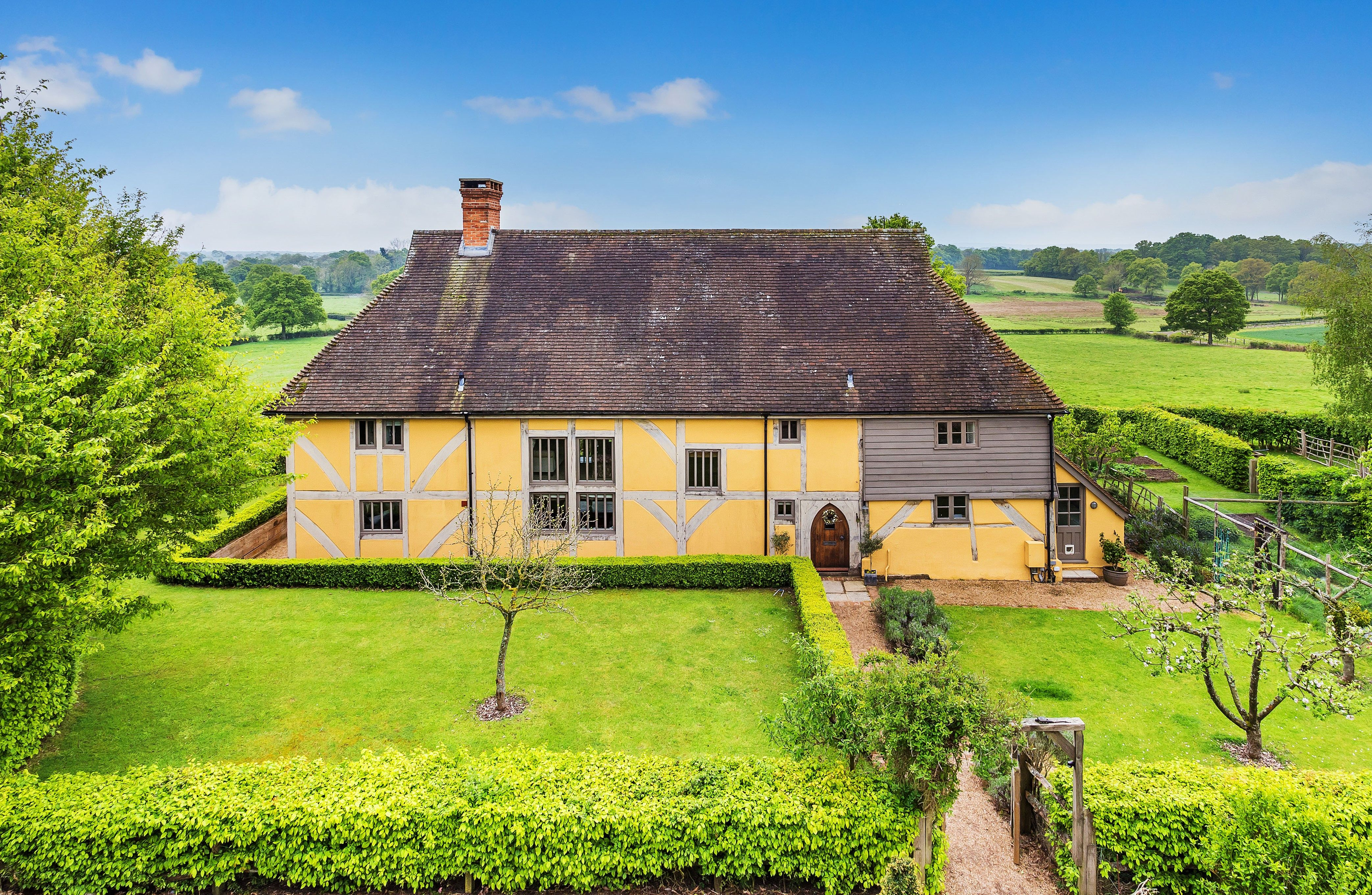 Quaint yellow cottage from Escape to the Country for sale in Surrey