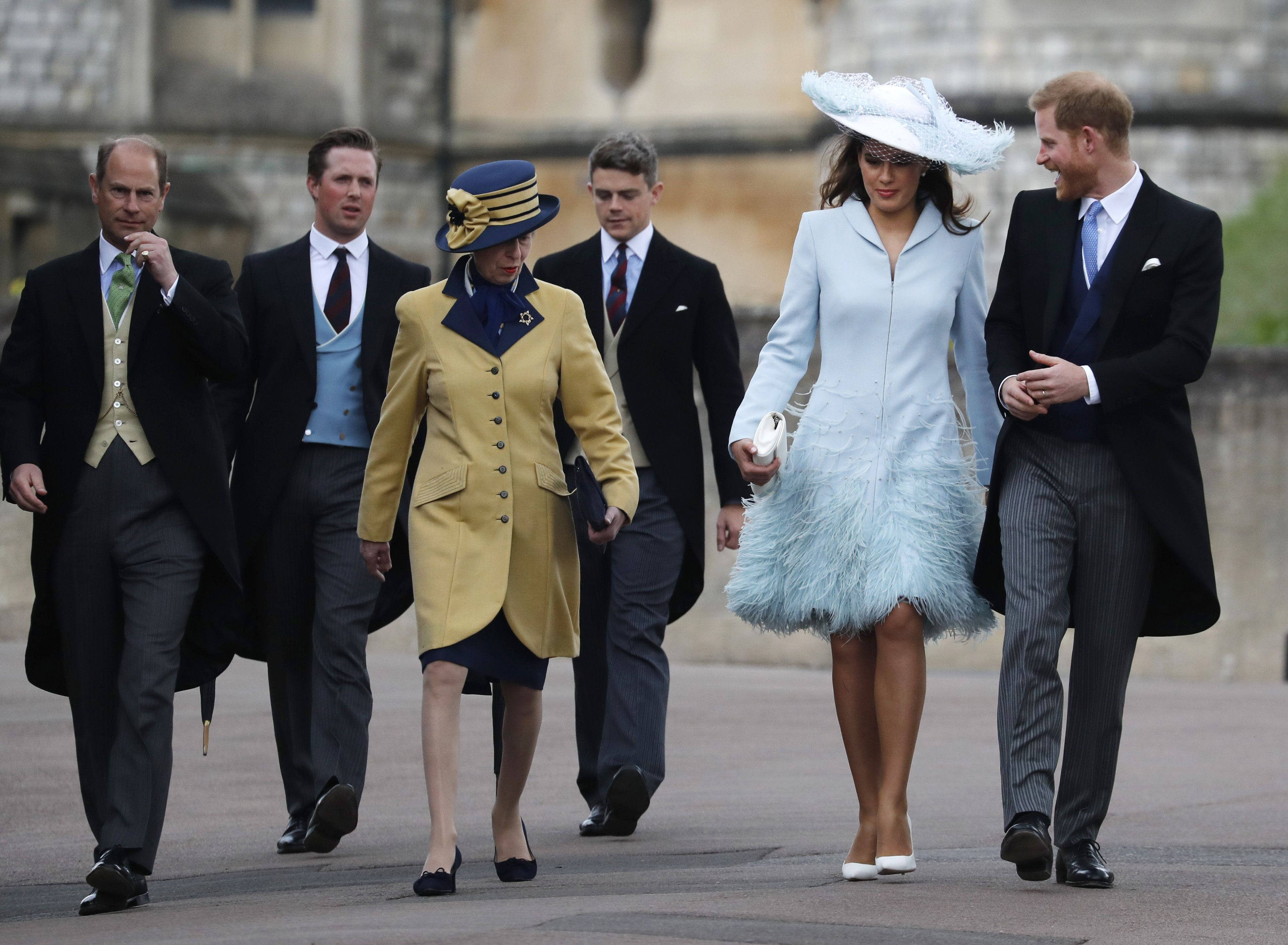 Prince Harry walks to Ella Windsor's wedding alongside the sister-in-law of the bride, Lady Frederick Windsor.