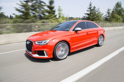 front and side view of a red audi rs3 sedan sports car in motion