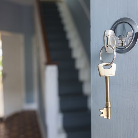 Front door of house with key in lock