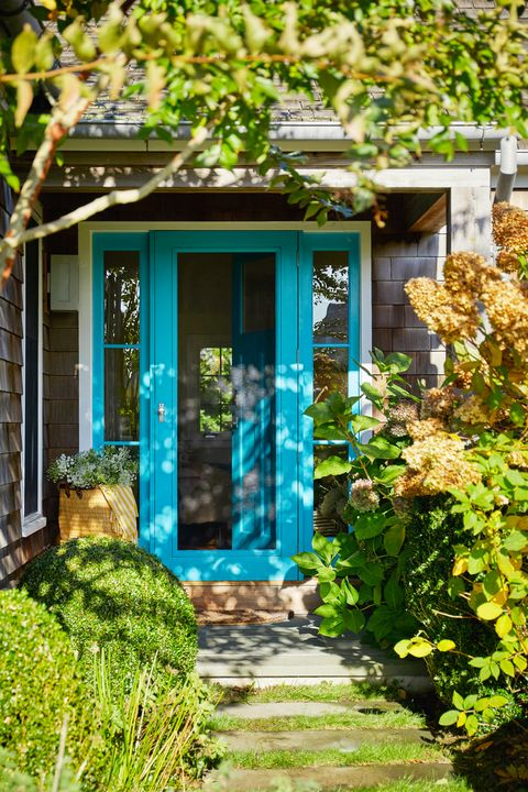 front porch with blue door frame