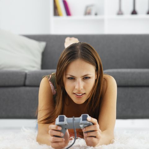 front view portrait of young woman playing computer game