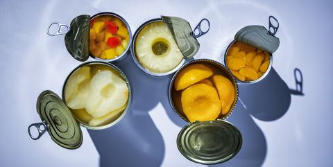Fruit in opened tin cans