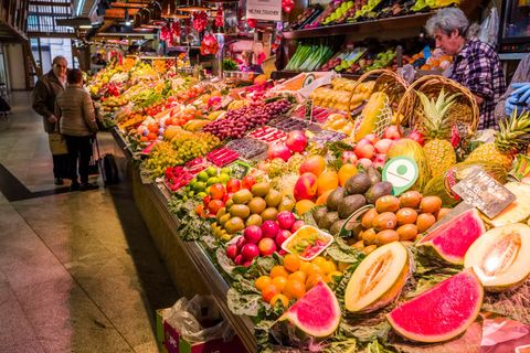 Fruits and vegetables are sold inside the Mercat de Sant...