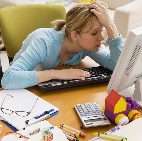 frustrated hispanic woman at desk surrounded by toys