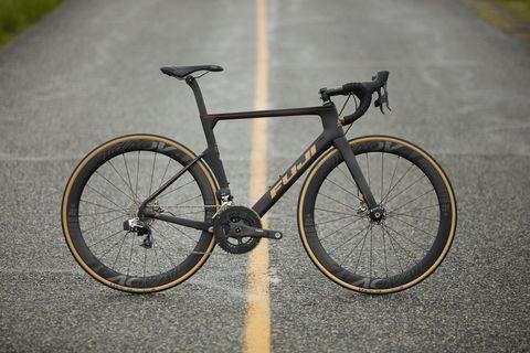 Land vehicle, Bicycle, Bicycle wheel, Vehicle, Bicycle part, Bicycle frame, Bicycle tire, Bicycle handlebar, Cycle sport, Spoke,