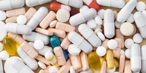 Full frame heap of various colors pills and capsules, close-up