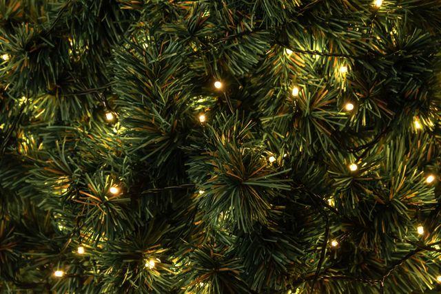 full frame shot of illuminated christmas decorations on christmas tree
