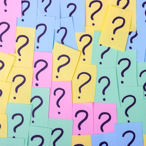 Full Frame Shot Of Question Marks On Colorful Adhesive Notes
