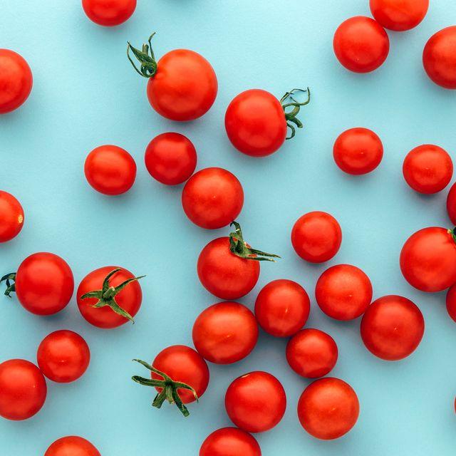 full frame shot of tomatoes against blue background