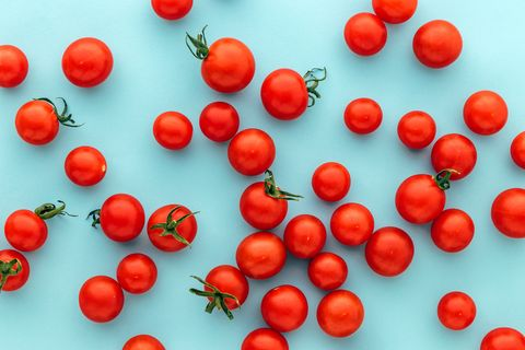 full frame shot of tomatoes against blue background