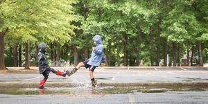 Full Length Of Children Playing In Park