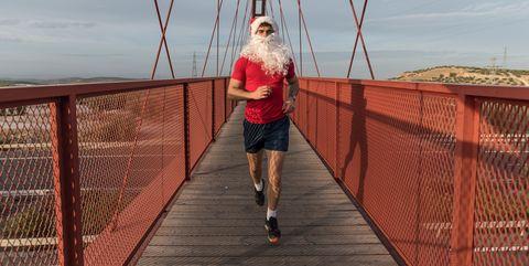 Full Length Of Man Jogging On Footbridge Against Sky