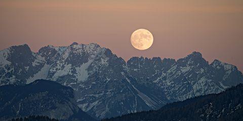 The full moon rising over the Kaiser Mountains, Tyrol, Austria