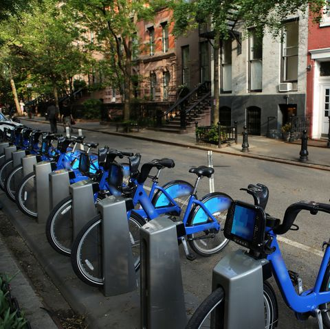 A full rack of citibikes in a street of the West Village, Manhattan, New York City