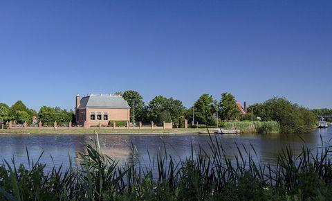 Water resources, Landscape, Bank, Land lot, Real estate, House, Reflection, Reservoir, Wetland, Lake,