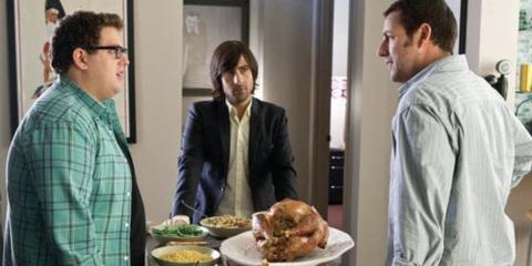jonah hill, jason schwartzman, and adam sandler around a table with a turkey on it