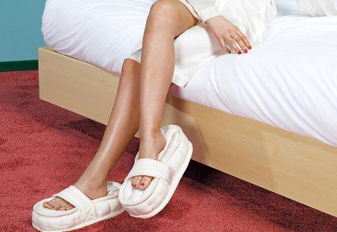 Footwear, White, Shoe, Leg, Human leg, Ankle, Joint, Plimsoll shoe, Human body, Foot,
