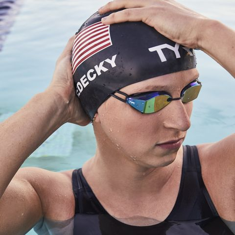 Swim cap, Cap, Endurance sports, Clothing, Triathlon, Swimmer, Recreation, Swimming pool, Headgear, Goggles,
