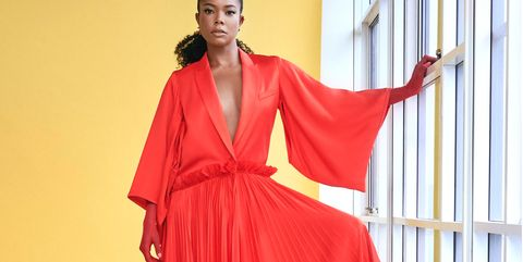 Clothing, Fashion model, Red, Shoulder, Fashion, Dress, Fashion design, Yellow, Haute couture, Formal wear,