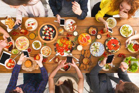 Gadget device addiction, friends dinner with smarphones