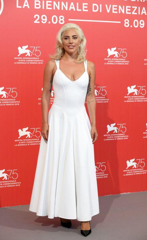 Clothing, Dress, White, Red carpet, Carpet, Premiere, Fashion model, Cocktail dress, Hairstyle, Fashion,