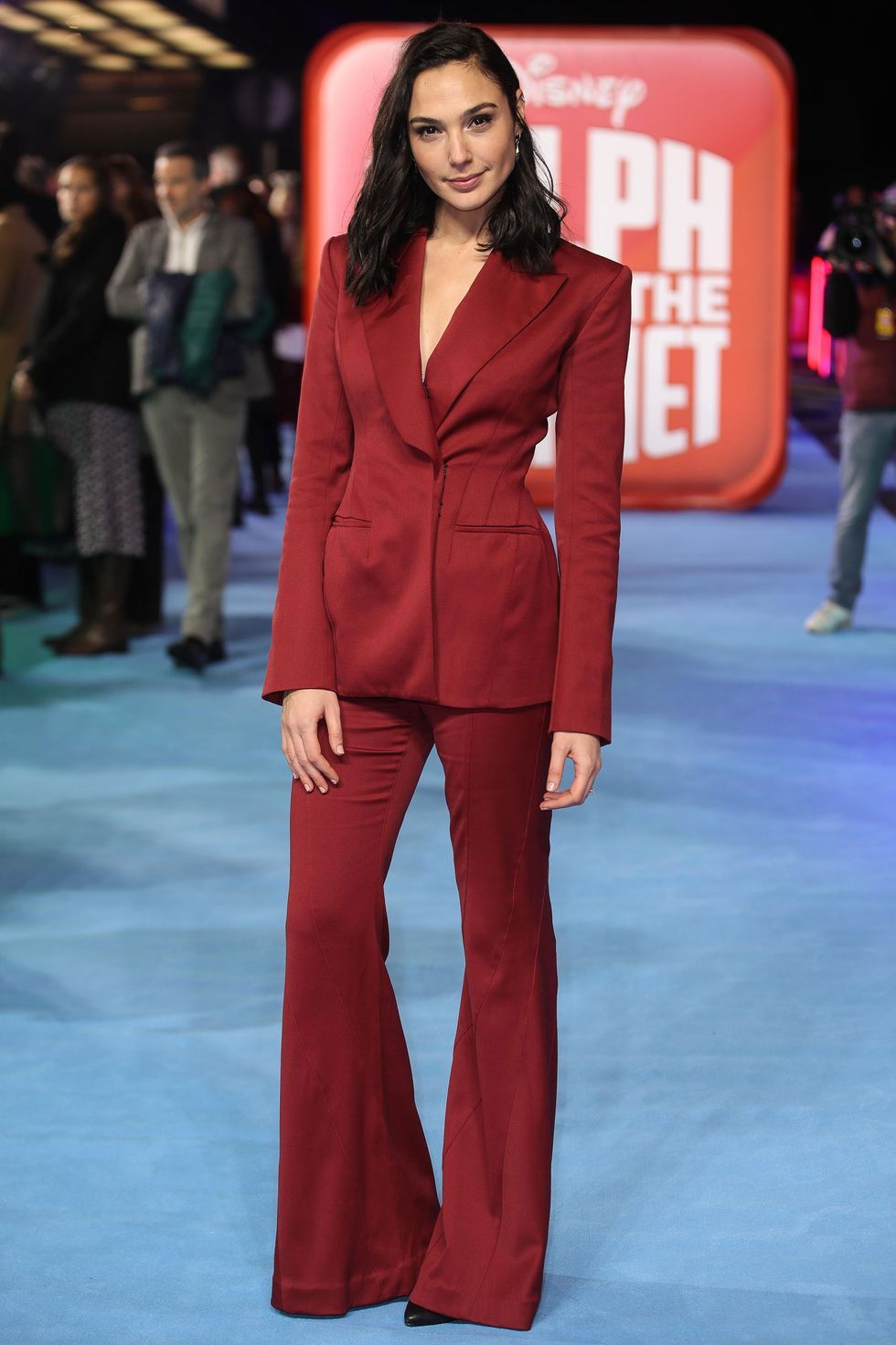 Gal Gadot wearing a red suit