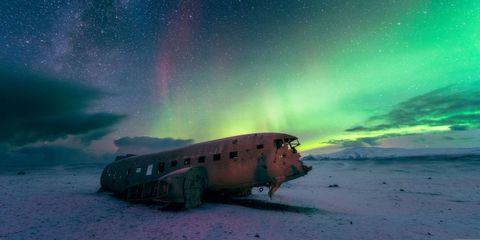 Aurora, Sky, Green, Natural environment, Landscape, Atmosphere, Atmospheric phenomenon, Space, Horizon, Star,