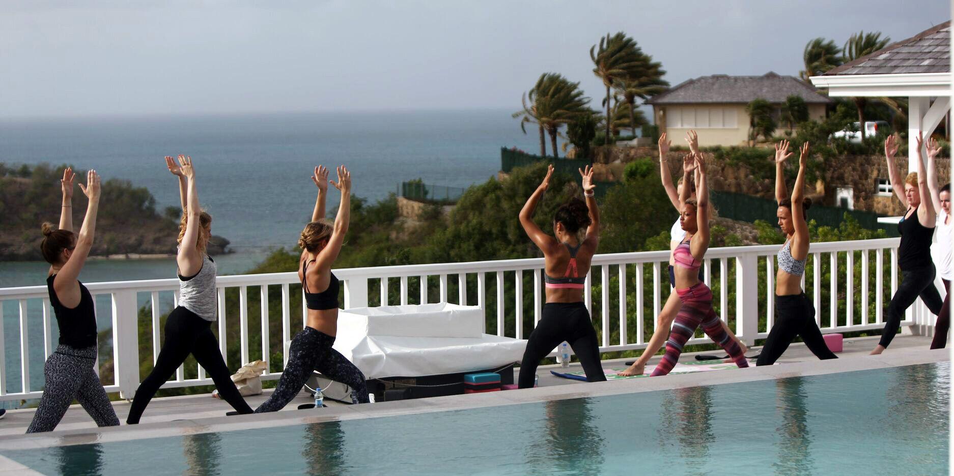 Women doing yoga at Jessica Skye Fat Buddha Yoga retreat at Galley Bay Resort and Spa