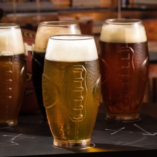 football shaped beer pint glasses and gold game day balloons