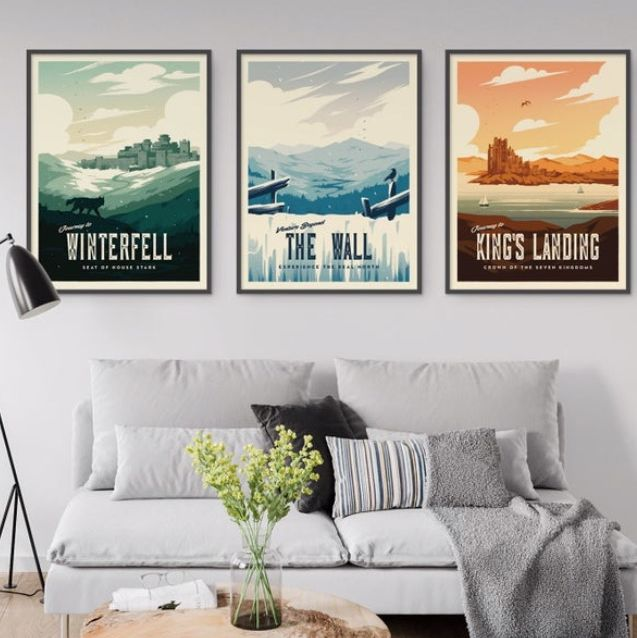 game of thrones posters in living room and winterfell candle