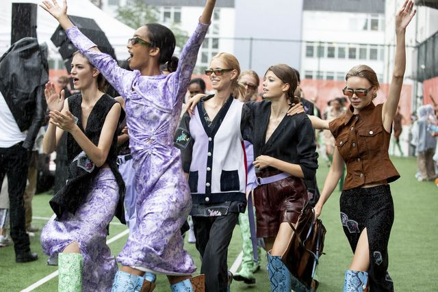 copenhagen, denmark   august 08 happy models walking and dancing in the rain at the final walk during  the ganni show during the copenhagen fashion week springsummer 2020 on august 08, 2019 in copenhagen, denmark photo by yuliya christensengetty images