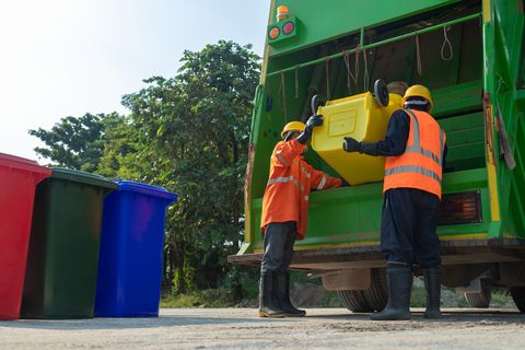 garbage collector asian worker of urban municipal recycling garbage collector truck loading waste and trash bin in thailand, trash keeper