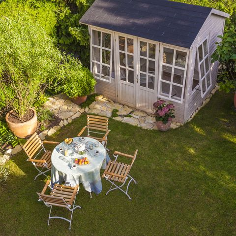garden shed and laid table in garden