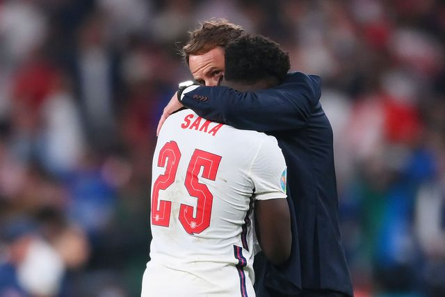 london, england   july 11 bukayo saka of england is consoled by gareth southgate, head coach of england following defeat in the uefa euro 2020 championship final between italy and england at wembley stadium on july 11, 2021 in london, england photo by laurence griffithsgetty images